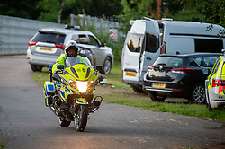 © Licensed to London News Pictures. 23/06/2020. Cookham, UK. A police officer on a motorcycle at the scene close to the river Thames. A search and rescue operation was launched Tuesday evening after reports that several people, believed to be refugees from Syria, got into difficulties, it is understood that one person was rescued and transferred to hospital and one person remained unaccounted for. Multiple emergency resources were deployed to the scene, close to Odney Common in Cookham, including lowland search and rescue teams. Photo credit: Peter Manning/LNP