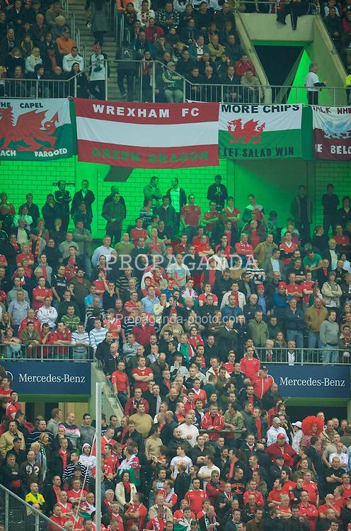 MONCHENGLADBACH, GERMANY - Wednesday, October 15, 2008: Wales supporters during the 2010 FIFA World Cup South Africa Qualifying Group 4 match against Germany at the Borussia-Park Stadium. Wrexham FC Green Dragon Banner. (Photo by David Rawcliffe/Propaganda)