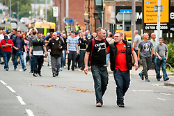 "Rotherham England<br /> 13 September 2014 <br /> EDL members and Supporters make their way back onto the official route after the EDL broke through a police cordon during the English Defence League Justice for the Rotherham 1400 March described by an EDL Facebook Page as ""a protest against the Pakistani Muslim grooming gangs"" on Saturday Afternoon <br /> <br /> <br /> Image © Paul David Drabble <br /> www.pauldaviddrabble.co.uk"