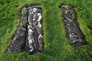 Two 17th century slabs, each 2.00m in length, bearing full-length effigies of a man and woman in Pennygowan Cemetery (Caol Fhaoileann), Salen Isle of Mull, Scotland. This ruined chapel, which served the N portion of the parish of Torosay, is probably of early 13th century date. No medieval references to it have been identified, and its dedication is unknown. The records of the Synod of Argyll in the middle of the 17th century show some uncertainty as to the status of the charge; it is referred to both as a 'Chappell' and as a 'paroach'. The building may already have been derelict at this period, although the earliest evidence of its condition dates from 1787 when it was shown as 'an old kirk' on a map of Torosay parish. Salen (Scottish Gaelic: An t-Sàilean) is a settlement on the Isle of Mull, Scotland. It is on the east coast of the island, on the Sound of Mull, approximately halfway between Craignure and Tobermory. The full name of the settlement is 'Sàilean Dubh Chaluim Chille' (the black little bay of St Columba)...http://www.undiscoveredscotland.co.uk/mull/pennygown/index.html