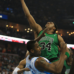 11 February 2009: Boston Celtics forward Paul Pierce (34) shoots over New Orleans Hornets center Hilton Armstrong (12) during a NBA game between the Boston Celtics and the New Orleans Hornets at the New Orleans Arena in New Orleans, LA.
