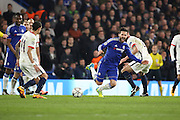 Chelsea midfielder Cesc Fabregas (4) getting fouled during the Champions League match between Chelsea and Paris Saint-Germain at Stamford Bridge, London, England on 9 March 2016. Photo by Matthew Redman.