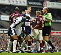 Photo: Chris Ratcliffe.<br />Tottenham Hotspur v Arsenal. The Barclays Premiership.<br />29/10/2005.<br />Mido pushes Freddie Ljungberg as Michael Dawson also gets involved as tempers fray at White Hart Lane