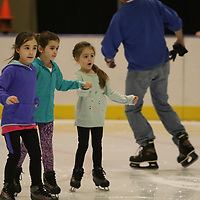 From left, Makenzie Caples,7, Olivia Moore, 6, and Ava Kate Moody, 5, skate hand-in-hand Saturday at the Bancorpsouth Arena