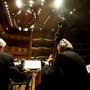 "March 11, 2013 - New York, NY : .Foreground from left, bassists George Peniston, Laurence Lovelle, and Kevin Rundell, with the London Philharmonic Orchestra, performs Gustav Mahler's Symphony No. 5 in C-sharp minor (1901-02), as part of Lincoln Center's ""Great Performers"" series at Avery Fisher Hall on Monday evening..CREDIT: Karsten Moran for The New York Times"