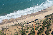 The Island from Above. Fishing 'wadiya' in the South near Weerawila. Fishing huts and catamarans on the beach.