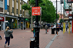 Covid-19 sign in Broad Street. Easing of Coronavirus lockdown, Reading, UK 12 June 2020