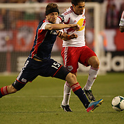 Fabian Espindola, (right), New York Red Bulls, is challenged by Stephen McCarthy, during the New York Red Bulls V New England Revolution, Major League Soccer regular season match at Red Bull Arena, Harrison, New Jersey. USA. 20th April 2013. Photo Tim Clayton