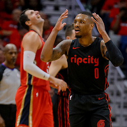 Apr 19, 2018; New Orleans, LA, USA; Portland Trail Blazers guard Damian Lillard (0) reacts to a foul during the second half in game three of the first round of the 2018 NBA Playoffs against the New Orleans Pelicans at the Smoothie King Center. The Pelicans defeated the Trail Blazers 119-102.  Mandatory Credit: Derick E. Hingle-USA TODAY Sports