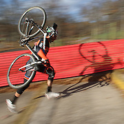 A competitor tackles the stairway during the Cyclo-Cross, Supercross Cup 2013 UCI Weekend at the Anthony Wayne Recreation Area, Stony Point, New York. USA. 24th November 2013. Photo Tim Clayton