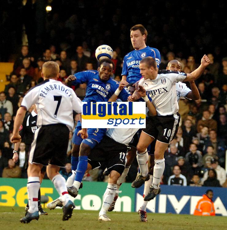 Photo: Ed Godden.<br /> Fulham v Chelsea. The Barclays Premiership. 19/03/2006.<br /> Michael Essien and Frank Lampard (R) scramble in the Fulham area.