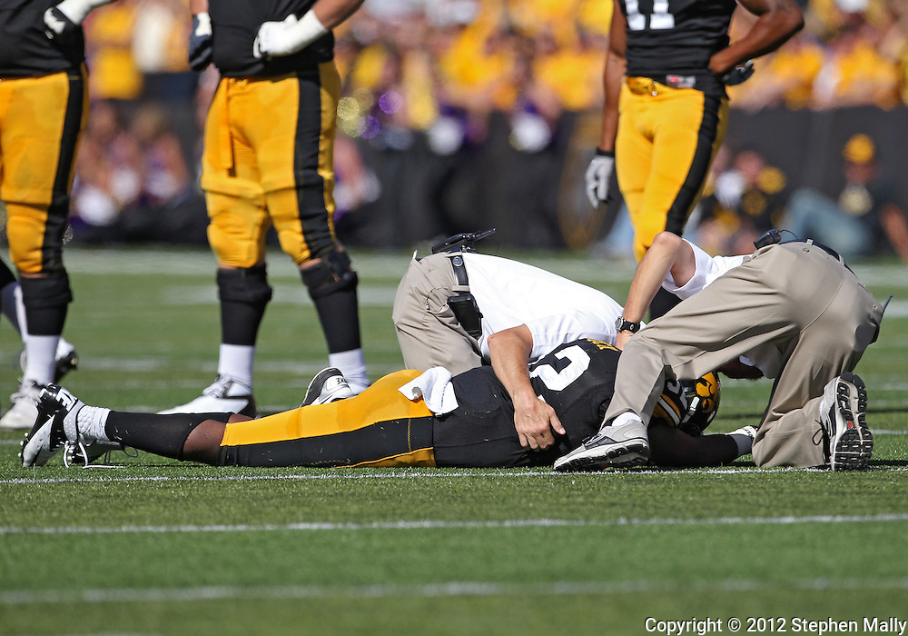 September 15 2012: Iowa Hawkeyes running back Damon Bullock (32) is assisted by trainers after being injured during the second quarter of the NCAA football game between the Northern Iowa Panthers and the Iowa Hawkeyes at Kinnick Stadium in Iowa City, Iowa on Saturday September 15, 2012. Bullock did not return to the game. Iowa defeated Northern Iowa 27-16.