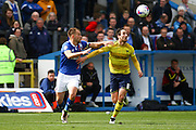 Carlisle United Defender Danny Grainger and Oxford forward Danny Hylton battle for the ball during the Sky Bet League 2 match between Carlisle United and Oxford United at Brunton Park, Carlisle, England on 30 April 2016. Photo by Craig McAllister.