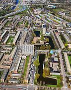 Nederland, Groningen, Groningen, 01-05-2013; De Wijert Noord. Rationele woonwijk uit de wederopbouwperiode. Karakteristieke afwisseling tussen (open) bebouwing en groene ruimtes. De verschillende soorten huizen herhalen zich (herhaalbare module van de wooneenheid ofwel stempels). Lichtblauwe puntdak van de Opstandingskerk rechts onder het midden op de foto. Linksboven de A28.<br /> New residential area in Groningen built during the period of Reconstruction after World War II . Characteristic alternation between (open) built-up area and green spaces. Rationalistic architecture.<br /> luchtfoto (toeslag op standard tarieven)<br /> aerial photo (additional fee required)<br /> copyright foto/photo Siebe Swart