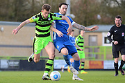 Forest Green Rovers forward Christian Doidge (9) battles with North Ferriby United defender Connor Oliver (4) 0-0 during the Vanarama National League match between Forest Green Rovers and North Ferriby United at the New Lawn, Forest Green, United Kingdom on 1 April 2017. Photo by Alan Franklin.