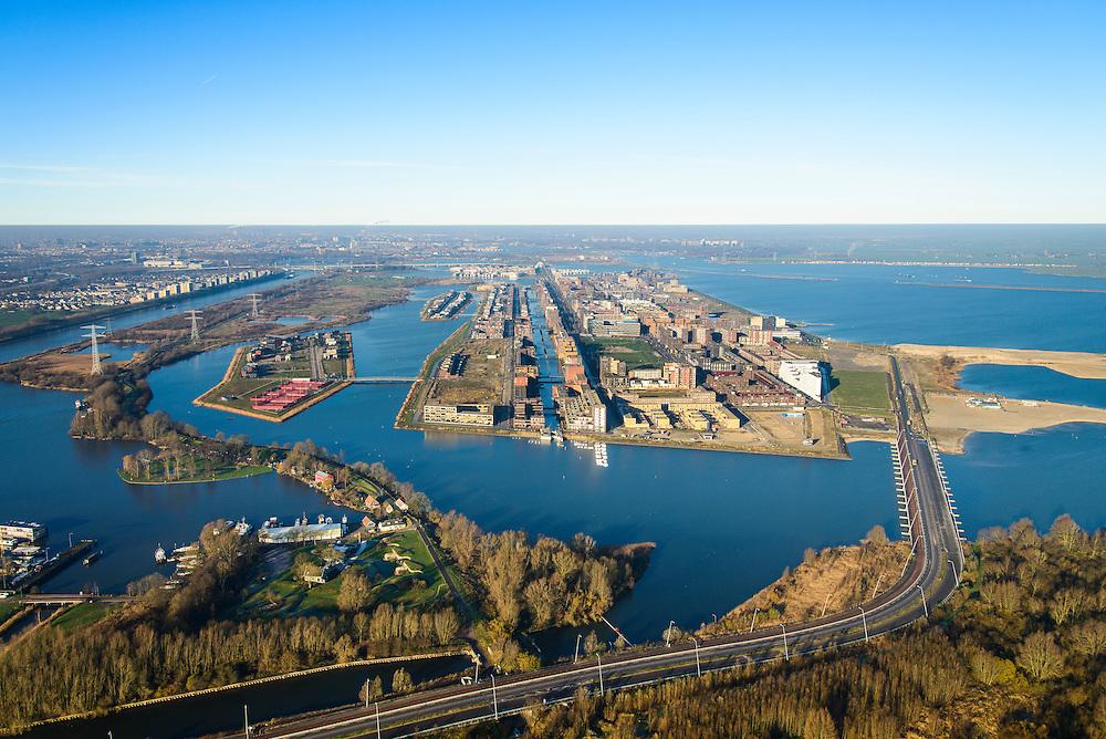 Nederland, Noord-Holland, Amsterdam, 11-12-2013; IJburg met Haveneiland en Rietlanden (li). Rechts Benno Premeselabrug en Blijburg, begin van IJburg II (Centrum eiland). Voorgrond Diemer Vijfhoek en Diemerzeedijk met Fort Dimen (Kustbatterij).<br /> Overview of IJburg, the new urban development district of Amsterdam, highrise buildings of the the Haveneiland( Harbour Island) (m).<br /> luchtfoto (toeslag op standard tarieven);<br /> aerial photo (additional fee required);<br /> copyright foto/photo Siebe Swart