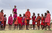 Maasai people preforming the traditional jumping dance in a Maasai village in Maasai Mara, Kenya.