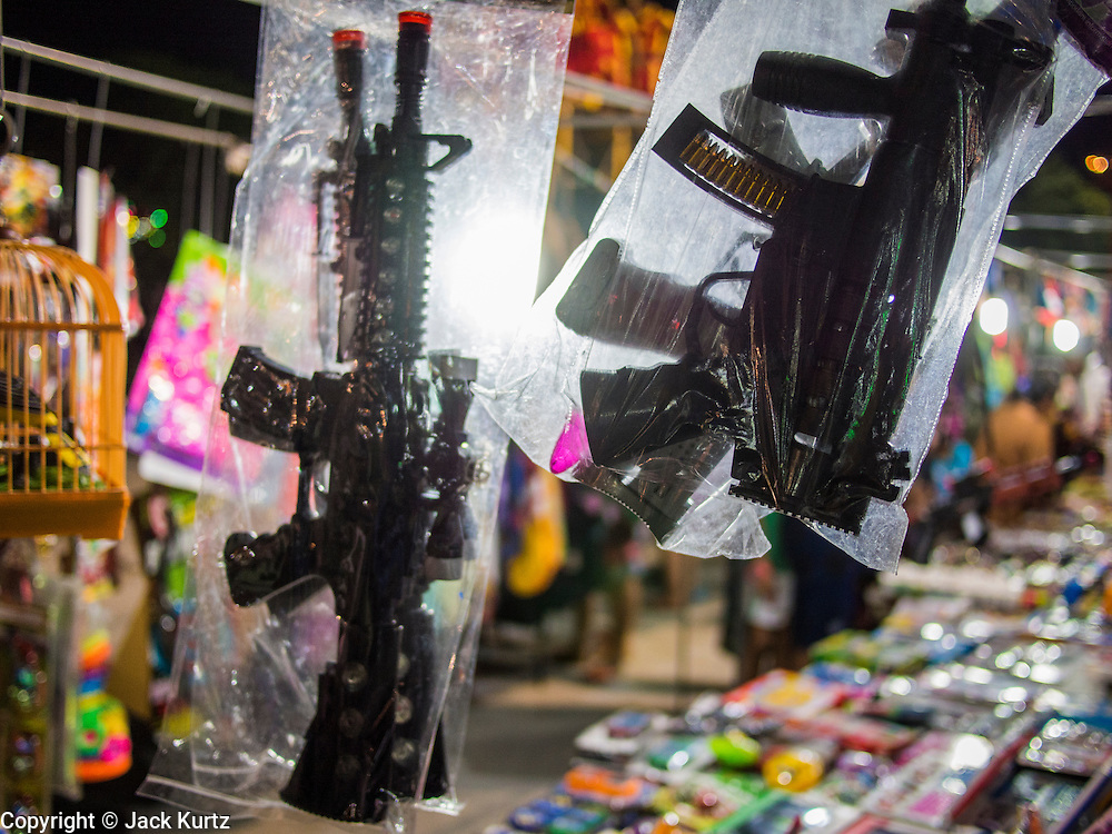 14 MARCH 2014 - NAKHON CHAI SI, NAKHON PATHOM, THAILAND: Toy guns for sale at the temple fair for the Wat Bang Phra tattoo festival.    PHOTO BY JACK KURTZ