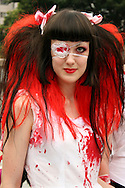 "Costume Play Bloody Brunette Nurse - A wide variety of ""costume play"" getups from nurses, bloddy nurses,  goths, cartoon characters from Japanese manga and anime...Every Sunday cosplayers meet up in Harajuku, Tokyo's fashion quarter and show their latest creations. Casual observers think that cos-play is a reaction to the rigid rules of Japanese society. But since so many cosplay girls Tokyo's fashion district HQ for Fendi, Hanae Mori and Issey Miyake, others consider it is a reaction to high fashion.  You can't help but imagine what they wear on Monday mornings though."