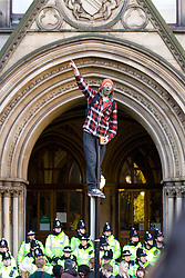 © under license to London News Pictures. 24/11/2010: Students in Manchester protest against cutbacks and the coalition government's proposed rise in tuition fees. Some surrounded the Town Hall and chanted slogans as police blocked entrances.