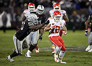 Kansas City Chiefs wide receiver Albert Wilson (12) gets tackled by Oakland Raiders outside linebacker Sio Moore (55) as he catches a pass good for a 23 yard gain to the Raiders 14 yard line in the fourth quarter during the NFL week 12 regular season football game against the Oakland Raiders on Thursday, Nov. 20, 2014 in Oakland, Calif. The Raiders won their first game of the season 24-20. ©Paul Anthony Spinelli