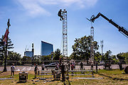 Philadelphia, Pennsylvania - September 16, 2015: John Gambone, top, helps erect one of the 30 trusses for the video walls which will line the Benjamin Franklin Parkway during the Pope's visit to Philadelphia.<br /> <br /> Scott Mirkin's company ESM is heading the production of The World Meeting Of Families and Pope Francis's visit to Philadelphia this Fall. The events will take place along the Benjamin Franklin Parkway.<br /> <br /> CREDIT: Matt Roth for The New York Times<br /> Assignment ID: 30179397A