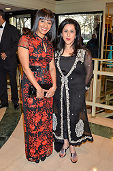 Left to right, radio presenter RANVIR SINGH and TV presenter ANITA ANAND at the 6th annual Asian Awards held at The Grosvenor House Hotel, Park Lane, London on 8th April 2016.