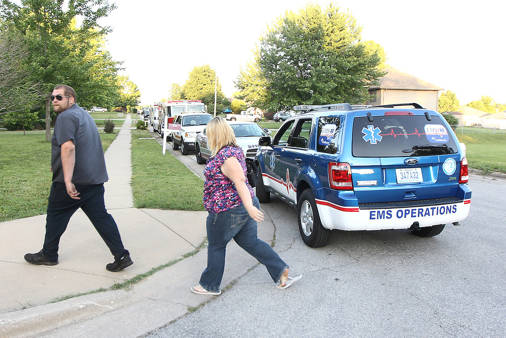 "Residents walk back to their homes in the quarantine zone after the ""all clear"" was given. A suspicious white powder was found in an envelope in a Southwest Missouri woman's mail on May 22, 2012 in Springfield, Missouri. (David Welker / TurfImages.com).."