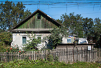 Russia, Sakhalin, Yuzhno-Sakhalinsk. A wooden house outside the city center.