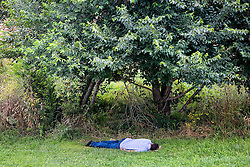 Barcelona, Catalunya, Spain.A man taking a siesta.© Carmen Secanella