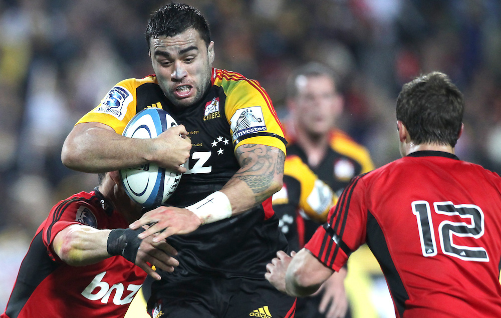 Chiefs' Liam Messam is challenged by Crusaders' Dan Carter and Tom Taylor in a Super Rugby semi final match, Waikato Stadium, Hamilton, New Zealand, Saturday, July 27, 2013.  Credit:SNPA / David Rowland