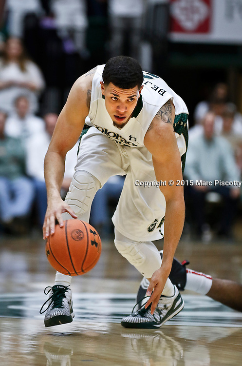 SHOT 1/24/15 9:43:59 PM - Colorado State's Daniel Bejarano #2 picks up a loose ball against San Diego State during their regular season Mountain West basketball game at Moby Arena in Fort Collins, Co. Colorado State won the game 79-73. (Photo by Marc Piscotty / © 2015)