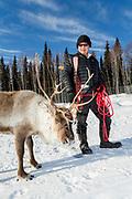 Kenji Yoshikawa with his reindeer at his farm outside Fairbanks, Alaska, USA.