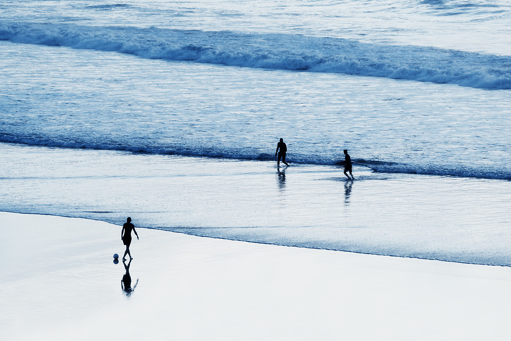 Football players at the beach.