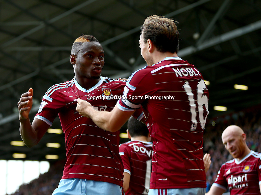 25 October 2014 - Barclays Premier League - West Ham v Manchester City - Diafra Sakho of West Ham celebrates scoring the winning goal with Mark Noble - Photo: Marc Atkins / Offside.