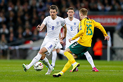 Michael Carrick of England (Manchester United) is challenged by Karolis Chveduka of Lithuania - Photo mandatory by-line: Rogan Thomson/JMP - 07966 386802 - 27/03/2015 - SPORT - FOOTBALL - London, England - Wembley Stadium - England v Lithuania UEFA Euro 2016 Qualifier.