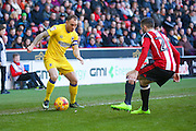 AFC Wimbledon defender Barry Fuller (2) takes on Sheffield United defender, on loan from Burnley, Danny Lafferty (24)  during the EFL Sky Bet League 1 match between Sheffield Utd and AFC Wimbledon at Bramall Lane, Sheffield, England on 4 February 2017. Photo by Simon Davies.