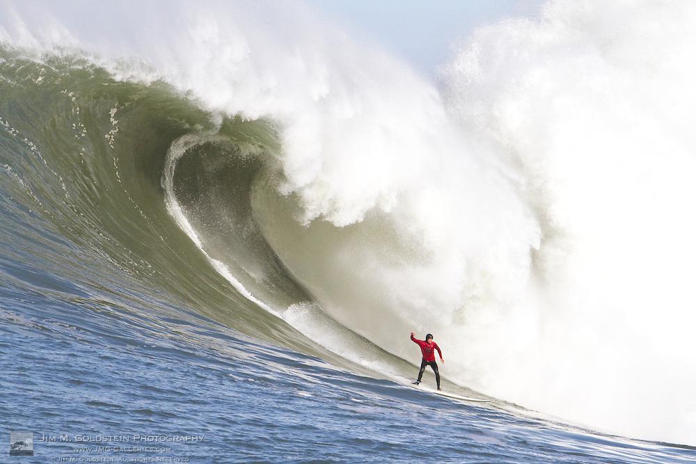 Alex Martins drops into a huge wave at the 2010 Mavericks Surf Contest - Half Moon Bay, California