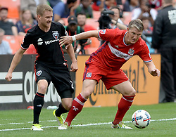 May 20, 2017 - Washington, DC, USA - 20170520 - Chicago Fire midfielder BASTIAN SCHWEINSTEIGER (31) plays the ball away from D.C. United defender TAYLOR KEMP (2) in the first half at RFK Stadium in Washington. (Credit Image: © Chuck Myers via ZUMA Wire)