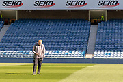 Interim Celtic Manager Neil Lennon stands alone on the Ibrox turf ahead of the Ladbrokes Scottish Premiership match between Rangers and Celtic at Ibrox, Glasgow, Scotland on 12 May 2019.