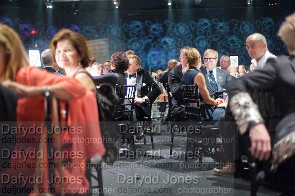 DAVID FURNISH; SIR ELTON JOHN, Grey Goose Winter Ball to Benefit the Elton John AIDS Foundation. Battersea park. London. 29 October 2011. <br /> <br />  , -DO NOT ARCHIVE-© Copyright Photograph by Dafydd Jones. 248 Clapham Rd. London SW9 0PZ. Tel 0207 820 0771. www.dafjones.com.
