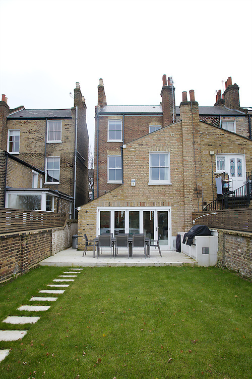 The back garden looking towards the house at 31 Groombridge Road, Hackney, London CREDIT: Vanessa Berberian for The Wall Street Journal<br /> HACKNEY-Lana Wrightman