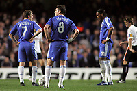Photo: Paul Thomas.<br /> Chelsea v Valencia. UEFA Champions League. Quarter Final, 1st Leg. 04/04/2007.<br /> <br /> (L-R) Dejected Andriy Shevchenko, Frank Lampard and Didier Drogba of Chelsea after Valencia score.