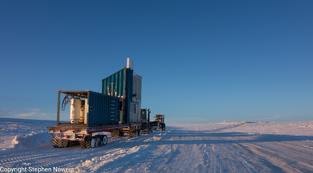 A Cruz Construction steiger hauls rig components up an ice road to a Linc Energy ice pad in Umiat, Alaska, during the 2013-2014 winter season. Cruz Construction provided rig support for Linc Energy's drilling program in Umiat.