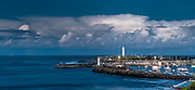 Panorama view of Wollongong Harbour with lighthouse and storm clouds out to sea.