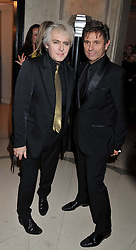 Left to right, NICK RHODES and ROGER TAYLOR at the Harper's Bazaar Women of the Year Awards 2011 held at Claridge's, Brook Street, London on 7th November 2011.