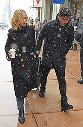 EXCLUSIVE: Marcus Mumford was left with the luggage pulling it through the streets of Park City, Utah as wife Carey Mulligan carried a coffee. The married couple braved the snow at The Sundance Film Festival where Carey is promoting her upcoming movie Wildlife (2018). 20 Jan 2018 Pictured: Carey Mulligan, Marcus Mumford. Photo credit: Atlantic Images / MEGA TheMegaAgency.com +1 888 505 6342