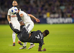 April 21, 2018 - Orlando, FL, U.S. - ORLANDO, FL - APRIL 21: Orlando City midfielder Cristian Higuita (7) gets fouled during the MLS soccer match between the Orlando City FC and the San Jose Earthquakes at Orlando City SC on April 21, 2018 at Orlando City Stadium in Orlando, FL. (Photo by Andrew Bershaw/Icon Sportswire) (Credit Image: © Andrew Bershaw/Icon SMI via ZUMA Press)