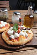 Individual Pizza with mozzarella cheese