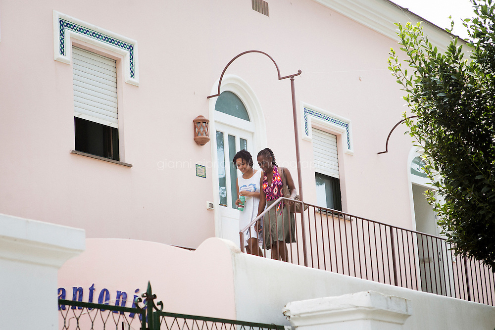 ANACAPRI, ITALY - 22 JULY 2014: (R-L) First Lady Chirlan McCray and her daughter Chiara De Blasio step outside their hotel room at Casa Mariantonia in Anacapri, a small comune on the island of Capri, Italy, on July 22nd 2014.<br /> <br /> New York City Mayor Bill de Blasio arrived in Italy with his family Sunday morning for an 8-day summer vacation that includes meetings with government officials and sightseeing in his ancestral homeland.